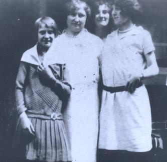 Nan as a teenager with her mother and two sisters. Left to right: Dorothy, mother Laura, Mae, and another sister (Helen or Jane). I love this photo because it is the one I have of my grandmother at the youngest age and her expression shows her humor.