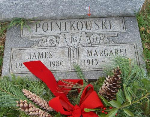"The final name misspelling for James: they accidentally carved a ""W"" into his tombstone and ""corrected"" it to a ""U"". A larger, correctly spelled stone is also in place."