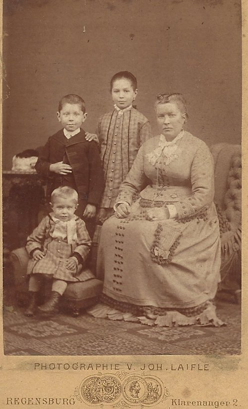 Ursula with her children Hilaury, Joseph (standing), and Ignatz. Taken in Regensburg, Germany, in approximately 1879-80.